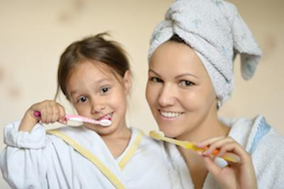 mom and daughter brushing teeth before general dentistry in boise id