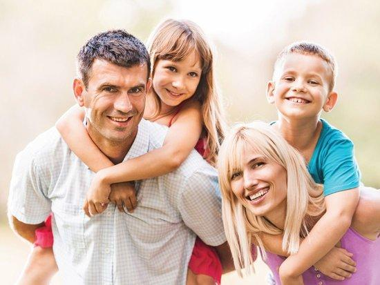 young family smiling | boise id dentist