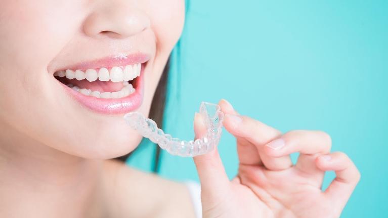 lady with invisalign aligner | invisalign boise id