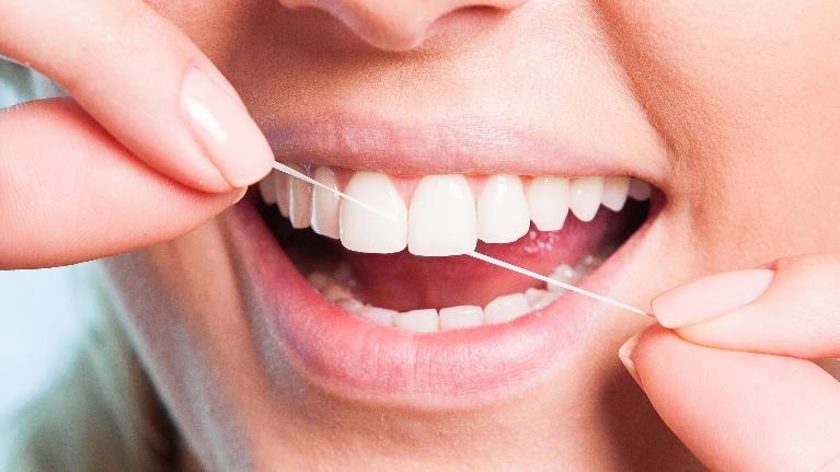 Flossing and Dental Implants | Atlantis Dental Care